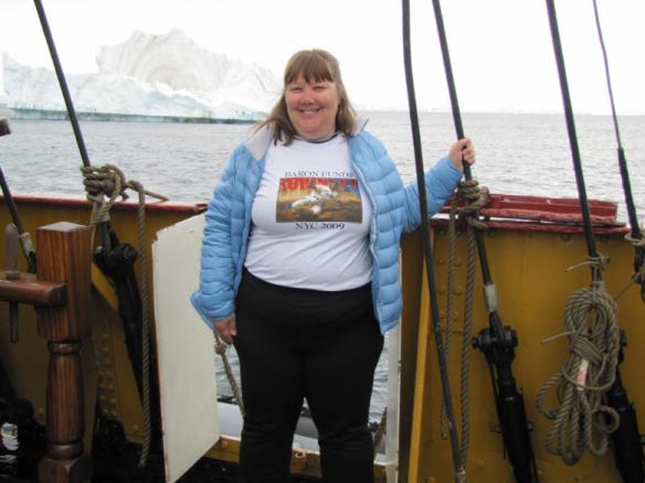Woman wearing Baron t-shirt in Antarctica. Activating element opens larger version of image.