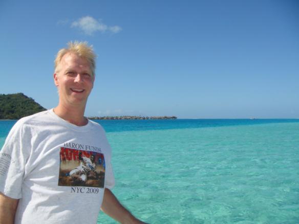Man wearing Baron t-shirt in Bora Bora. Activating element opens larger version of image.