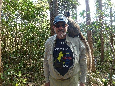 Man wearing Baron t-shirt in Madagascar. Activating element opens larger version of image.