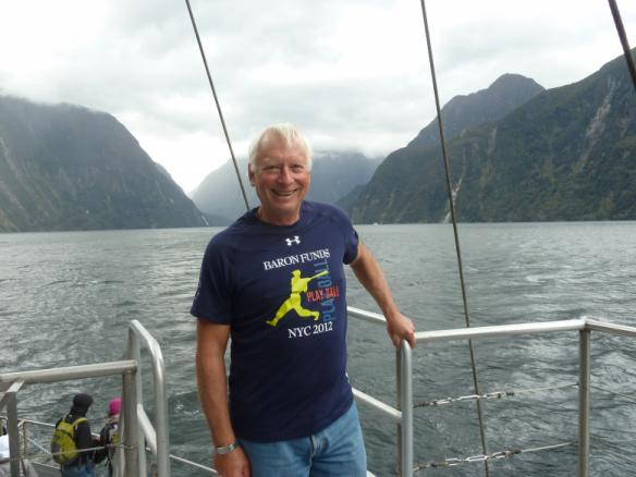 Man wearing Baron t-shirt in Milford Sound, New Zealand. Activating element opens larger version of image.