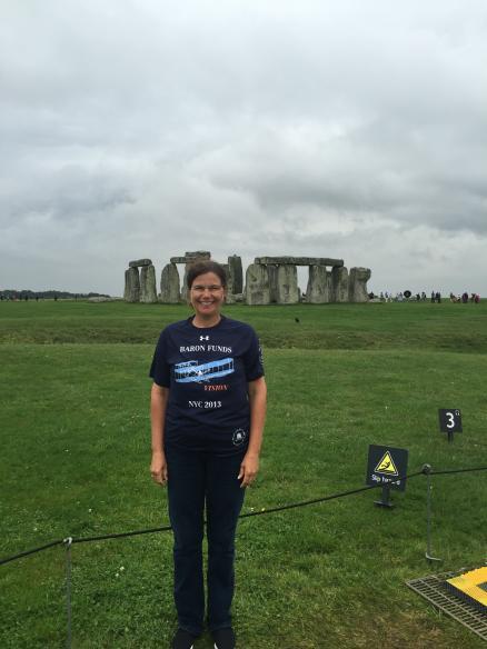 Woman wearing Baron t-shirt at Stonehenge, United Kingdom. Activating element opens larger version of image.