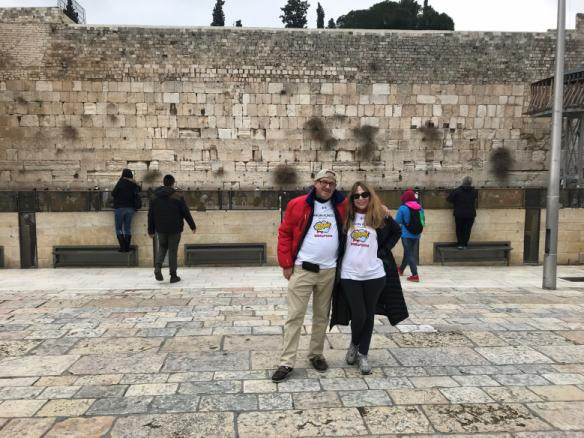 Two people wearing Baron t-shirts at the Western Wall, Israel. Activating element opens larger version of image.