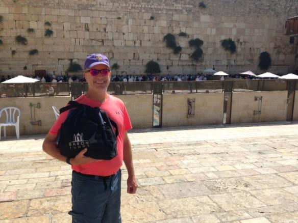 Man with Baron bag at the Western Wall in Jerusalem. Activating element opens larger version of image.